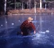 Fishing.Harry Bassett ice fishing on the Lamprey early 1960s.jpg
